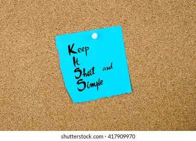 Business Acronym KISS as Keep It Short and Simple written on blue paper note pinned on cork board with white thumbtack, copy space available