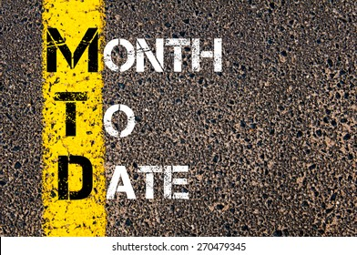 Business Acronym MTD - Month to Date. Yellow paint line on the road against asphalt background. Conceptual image