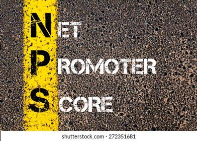 Business Acronym NPS as NET PROMOTER SCORE. Yellow paint line on the road against asphalt background. Conceptual image