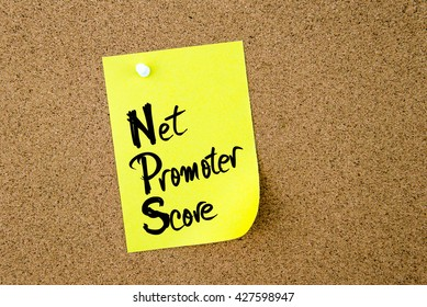 Business Acronym NPS Net Promoter Score written on yellow paper note pinned on cork board with white thumbtack, copy space available