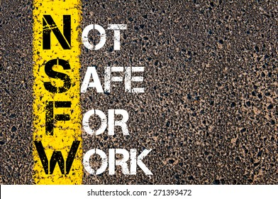 Business Acronym NSFW as NOT SAFE FOR WORK. Yellow paint line on the road against asphalt background. Conceptual image
