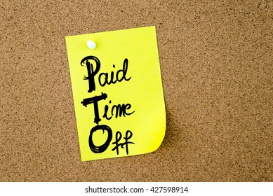 Business Acronym PTO Paid Time Off written on yellow paper note pinned on cork board with white thumbtack, copy space available
