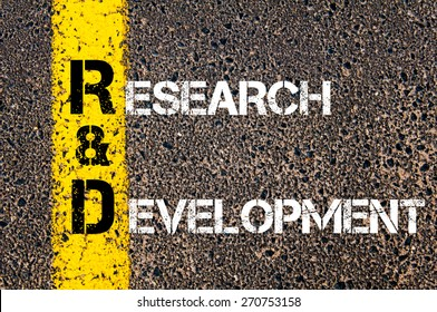 Business Acronym RD as Research and Development. Yellow paint line on the road against asphalt background. Conceptual image