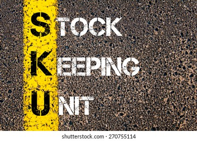 Business Acronym SKU as Stock Keeping Unit. Yellow paint line on the road against asphalt background. Conceptual image