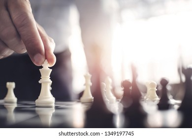 business administrator with chess board game, strategy and competition.