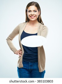 Business advertising concept with young smiling woman holding empty plate. Studio isolated portrait of female model with long hair.