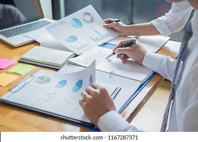 Business adviser analyzing financial figures denoting the progress Internal Revenue Service checking document. Audit concept