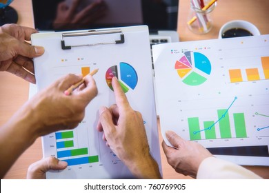 Business adviser analyzing financial figures denoting the progress in the work with team.