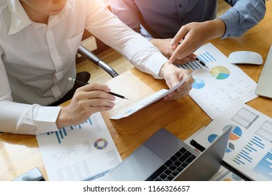 Business adviser meeting to analyze and discuss the situation on the financial report paper. Investment Consultant,Financial Consultant and accounting concept.