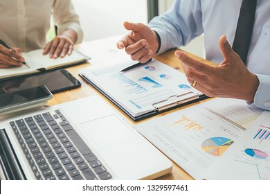 Business advisor analyzing financial figures denoting the progress Internal Revenue Service checking document. Audit concept