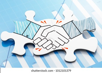 Business agreement. Handshake jigsaw puzzle pieces on blue chart. Concept image of business partnership and agreement.