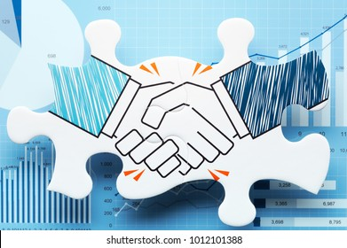 Business agreement. Handshake jigsaw puzzle pieces on blue charts. Concept image of business partnership and agreement.