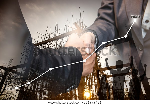 Business agreement success hand shaking about the construction of residential buildings.