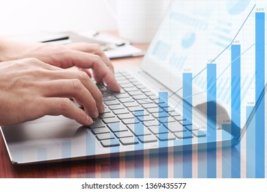 Business analysis concept. Businessman analyzing data and preparing reports. Laptop and growth graphs.