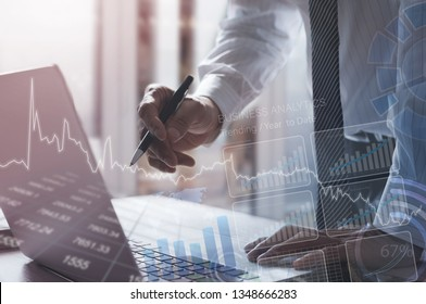 Business analysis and digital technology concept. Businessman analyzing digital graphic business data, working on laptop with computer dashboard, financial graph, stock market report on virtual screen