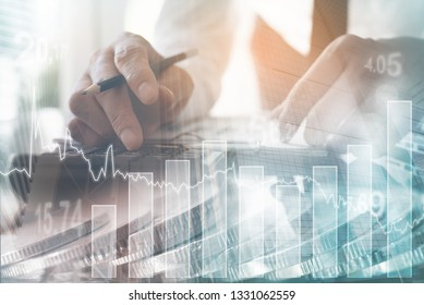 Business analysis, financial investment concept. Double exposure of businessman analyzing stock market, economic trend and bank buildings in the city with financial graph on virtual screen