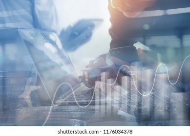 Business analysis, investment and modern technology concept. Business man analyzing financial report on laptop computer and mobile smart phone with graphics, stock exchange interface on screen