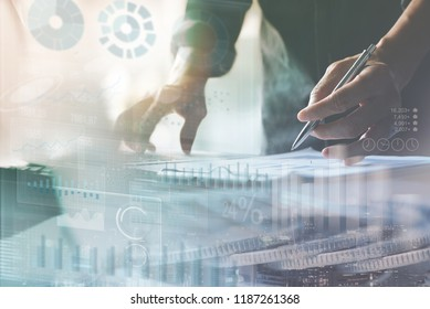 Business analysis, investment, modern technology concept. Double exposure, businessman analyzing financial report on laptop, modern graphic computer dashboard interface on screen at office and coins