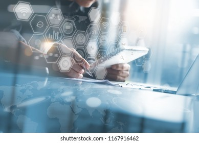 Business analysis and modern technology concept. Business man working on laptop computer, digital tablet at modern office with computer icons on virtual screen, IoT Internet of Things interface
