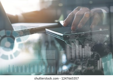Business analysis and modern technology concept. Businessman, analyzing business data on digital tablet and laptop computer on office desk, computer dashboard, stock market report on virtual screen