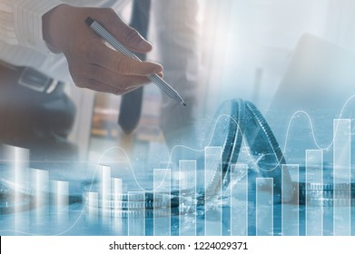 Business analysis, stock market analyzing, financial investment concept. Double exposure businessman, bank office and buildings background,  financial graph on virtual screen