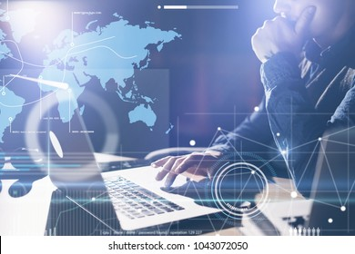 Business analyst is using laptop and researching the financial strategy at his office. Concept of a digital diagram, graph interface, virtual screen