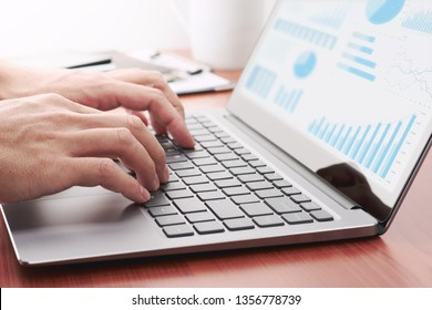 Business analytics concept. Businessman preparing reports. Laptop and many graphs.