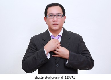business Asia man wearing formal suit and catching something.