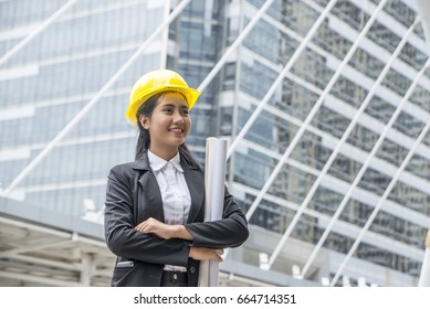 Business Asia woman engineer developer holding blueprint  working Confident  outdoors in construction site