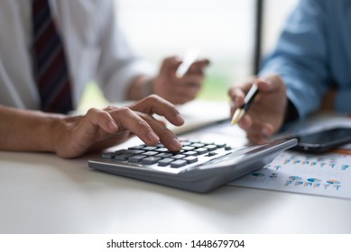 Business Asian middle age people using calculator to calculating finance bills of their activity and expenses.
