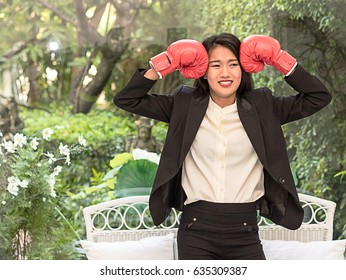 Business asian woman with boxing glove  ready to fighting with her work