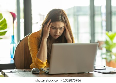 Business Asian woman have a Migraine so headache and stresses have a trouble and problem of her work,Office syndrome concept