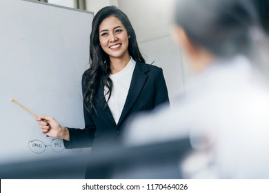 business asian woman present business finance plan strategy to his partner office backgrond