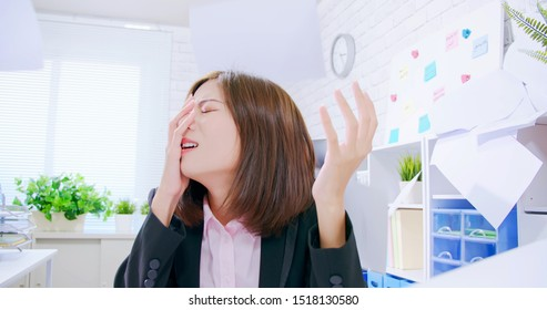 Business asian woman stressed and angry yelling in the office