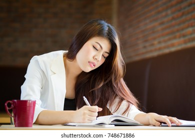 Business Asian women tired after take a long time working without break.