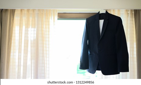 Business attire hanging, businessman suit, groom attire, men attire, men coat, men suit