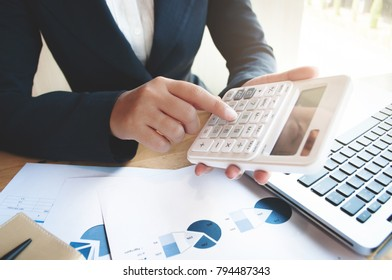business audit woman using calculator - finance and valuation concept