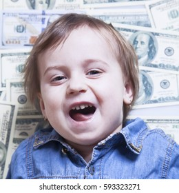 Business baby lying on the money as symbol of success rate and love of money