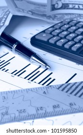 Business background in blues with graph, money, pen and calculator.