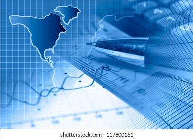 Business background in blues with graph, ruler, pen and calculator.