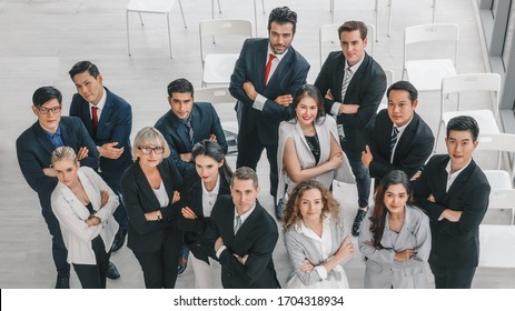 business background of diverse businesspeople standing together in a group and having arms cross showing confident in conference room