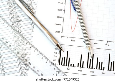 Business background with graph, ruler, pen and pencil.