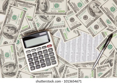 Business background with money american dollars, calculator and pen