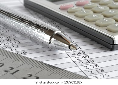 Business background table, ruler and calculator.