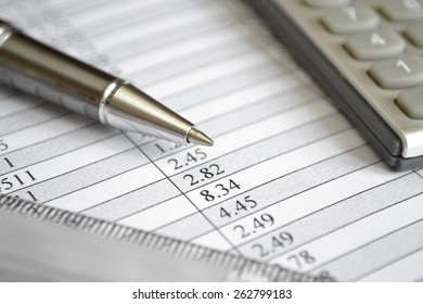 Business background with table, ruler, pen and calculator.