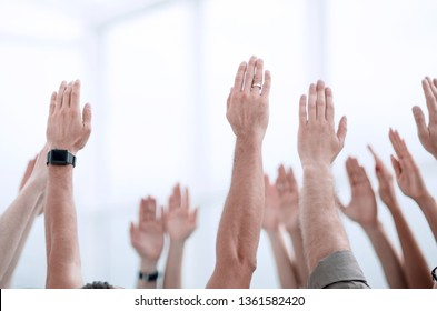 business background.the business team stands with their hands up
