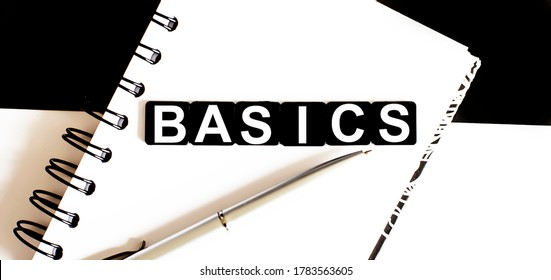 Business BASICS on notepad. Work business tex RISK