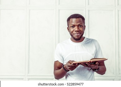 business black man holding a book