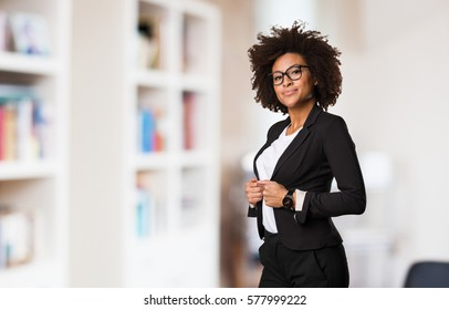 business black woman adjusting her clothes