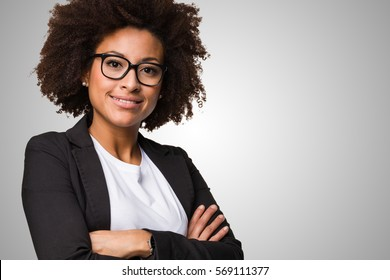 business black woman crossing her arms on a grey background